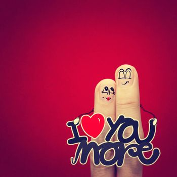 the happy vintage  finger couple in love with painted smiley and hold word love you more