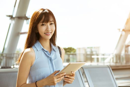 young business Woman Going To Work and holding the  tablet