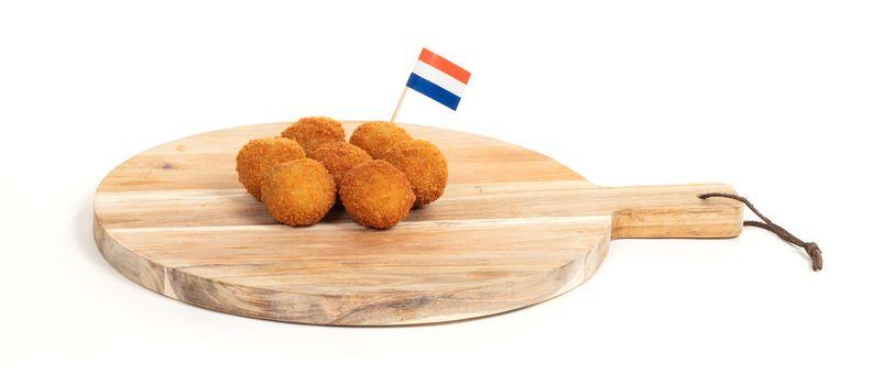Dutch traditional snack bitterbal on a serving board, dutch flag