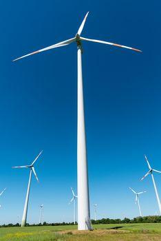 Wind farm with many wind wheels seen in Germany
