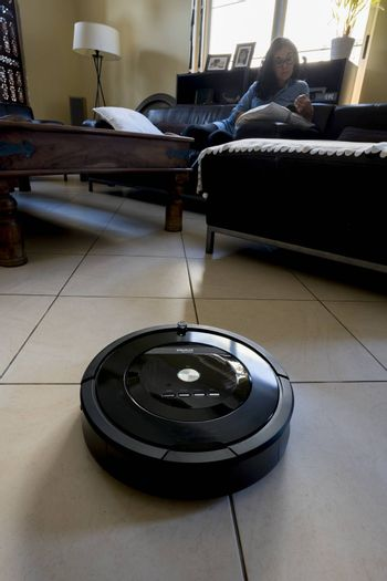 Roomba iRobot is an automated vacuum cleaning robot and powered by a rechargeable battery