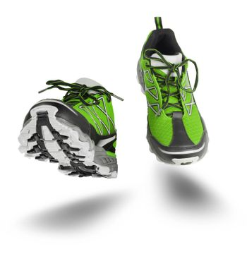 Green running sport shoes seen front, isolated on white background