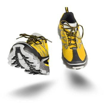 Yellow running sport shoes seen front, isolated on white background