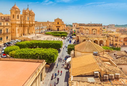 Cityscape of Noto. View of the central street with walking tourists. Province of Syracuse, Sicily, Italy