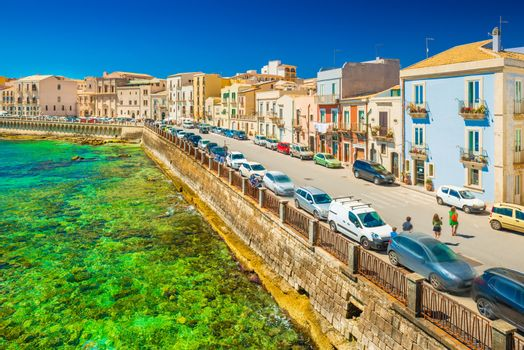 View of an embankment in Ortygia (Ortigia), Syracuse. Picturesque cityscape of an ancient historical town on Sicily, Italy