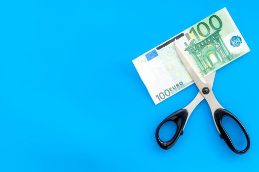 Cutting of euro banknote. Economic crisis concept