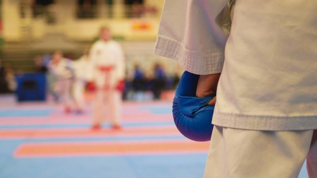 Teenager girls starts to fighting at the karate championship, close up