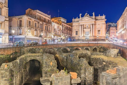 Catania - April 2019, Sicily, Italy: Night view of the Roman Amphitheater of Catania, ruins of an ancient theater in the famous Sicilian city