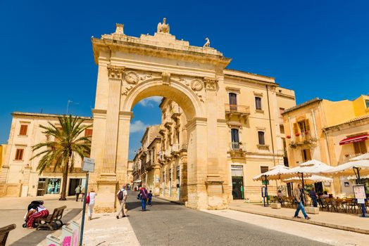 Noto - April 2019, Sicily, Italy: The City Gate in the Sicilian town which is considered as the capital of Italian Baroque