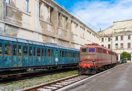 Trieste - March 2016, Italy: Electric locomotive and old train cars in Railroad Museum (Museo Ferroviario di Trieste), one of the landmarks in the capital of Friuli Venezia Giulia region