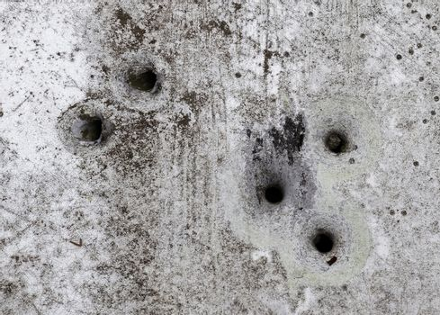Detailed close up of bullet holes from gun shots in a traffic si