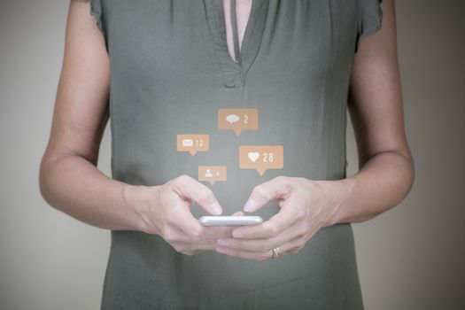 Woman interacting with her mobile and using online social media (elife), Marketing concept (light blur)