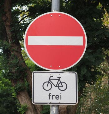no entry sign for cars, but bikes are allowed