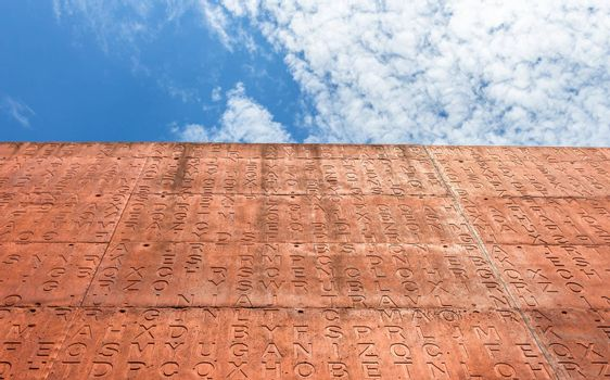 The outer wall of a library decorated with the letters of the alphabet.