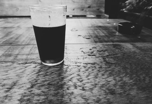 british ale beer pint and ashtray in black and white