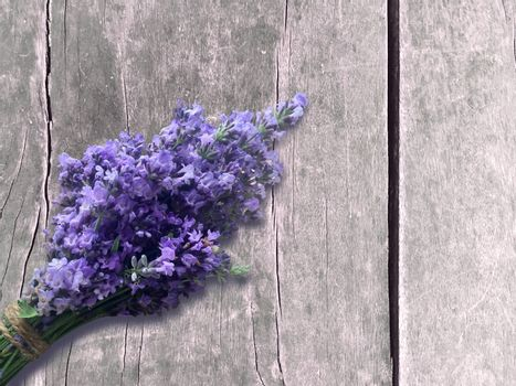 Bunch of blooming lavender, lavender bouquet on a grey wooden background. Rustic design.