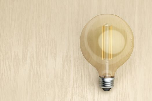 Decorative LED bulb on wooden desk