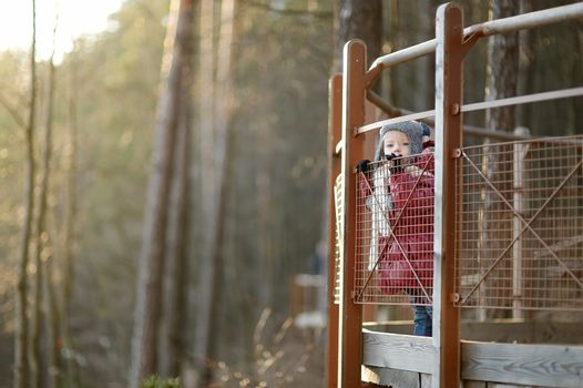 Adorable toddler girl enjoying a view on beautiful spring day