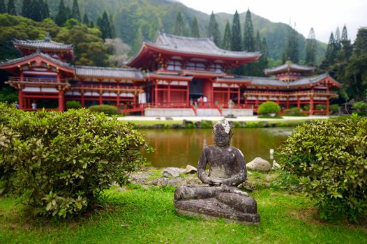 Gray Buddha statue in front of Byodo-in temple