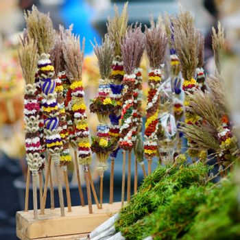 Traditional lithuanian Easter decorative palm bouquets sold on spring market