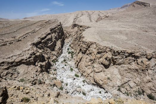 Dry river in the rocky and desert mountains of the Sultanate of Oman.