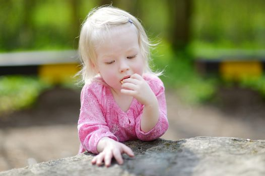 Adorable toddler girl on beautiful summer day outdoors