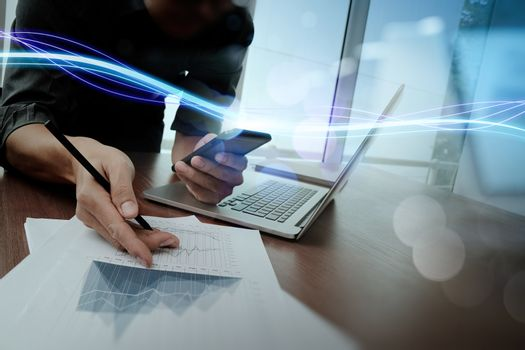 Waves of blue light and businessman using on smartphone as conce