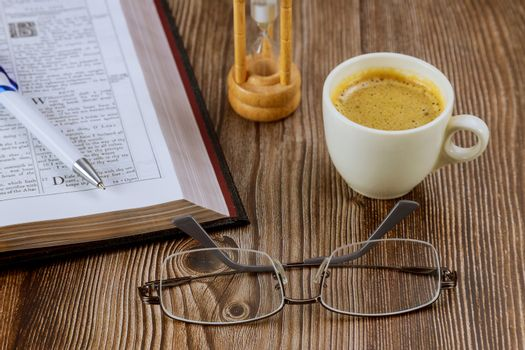 CHICAGO IL US 01 JULY 2020: Bible with eyeglasses a personal Holy Bible study with a cup of coffee