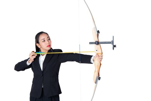 Portrait of concentrated female with crossbow in hands over whit