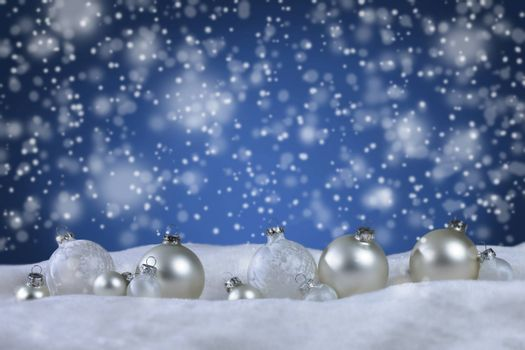 christmas balls with snow background with copy space