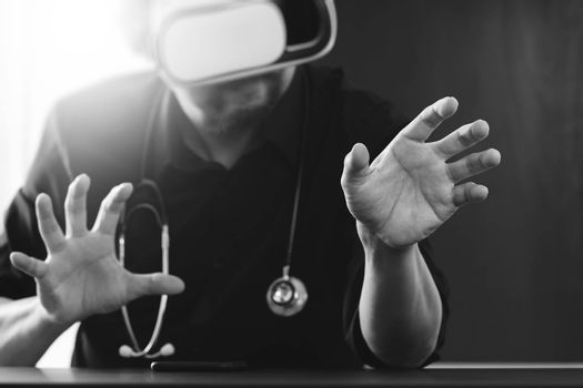smart doctor wearing virtual reality goggles in modern office with mobile phone using with VR headset,black and white