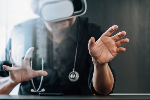 smart doctor wearing virtual reality goggles in modern office with mobile phone using with VR headset