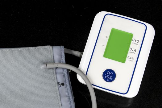 Automatic Blood Pressure Monitor with green screen on black background
