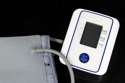 Automatic Blood Pressure Monitor with grey screen on black background
