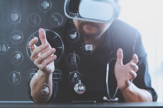 smart doctor wearing virtual reality goggles in modern office with mobile phone using with VR headset with screen icon diagram