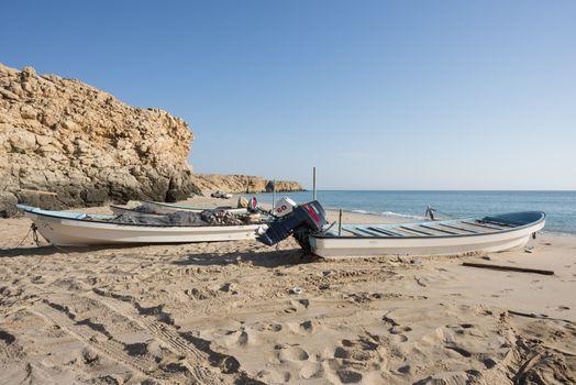 Fishermen boats on a beach of Ras Al Jinz, Sultanate of Oman