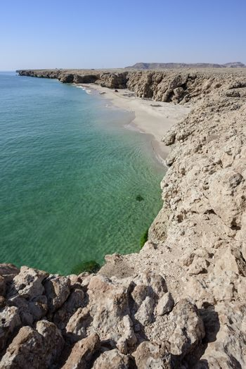 Top view from cliff of a wild beach at the coat of Ras Al Jinz, Sultanate of Oman.