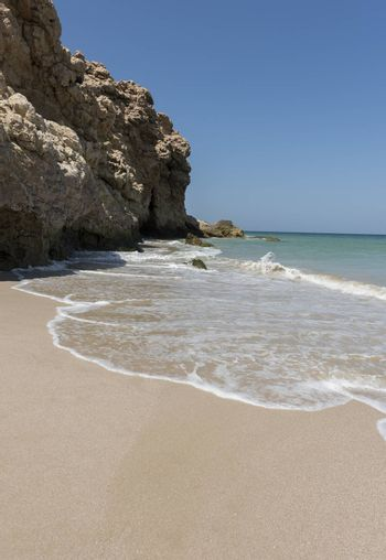 Wild beach at the coat of Ras Al Jinz, Sultanate of Oman. It is close to Ras Al Hadd and many turtles are coming in the region to nest
