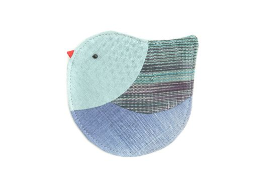 cute bird sew by cloth isolated on a white background