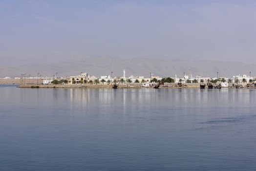 View of a part of the city called  Ar Rashah with mountains in background, Sur, Sultanate of Oman