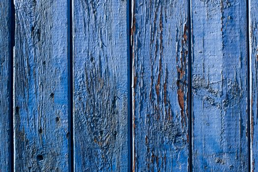 Texture of a board with blue peeling paint. Abstract background for design.