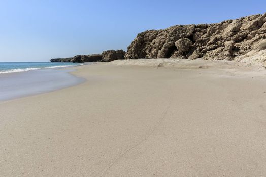 Wild beach at the coat of Ras Al Jinz, Sultanate of Oman. It is close to Ras Al Hadd and turtles are coming in the region to nest attracting many tourists