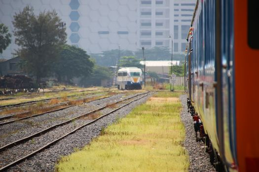 Arrival of a diesel passenger train at Phnom Penh station, Cambodia 1
