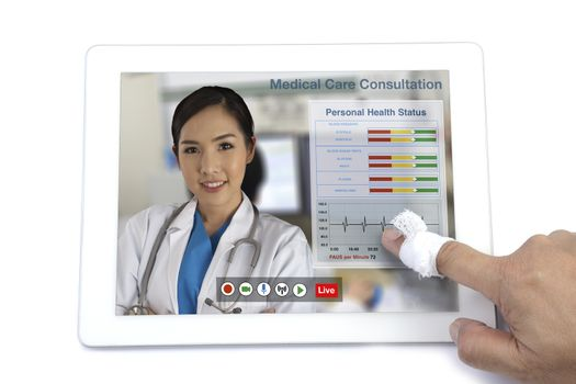 Patient get medical consultation from doctor by teleconference on digital tablet.