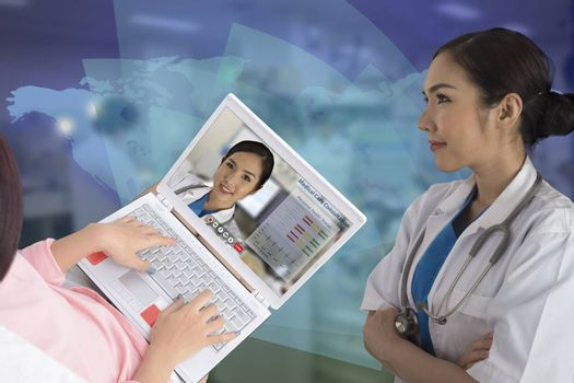 Photo of female doctor and her patien shown that patient seem to be closer to doctor by using teleconference for medical care consultation.