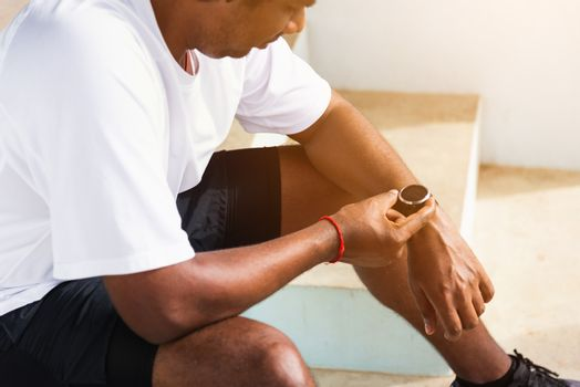 sport runner black man wear modern time smart watch he sitting r