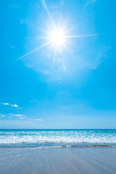 Sun shining bright over beautiful sea beach vertical shot