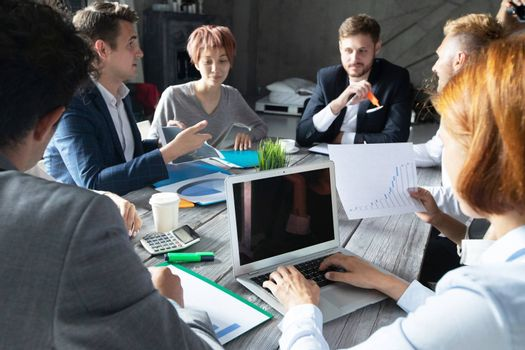 Business corporate management planning team concept, people sitting around office table and working with financial data reports