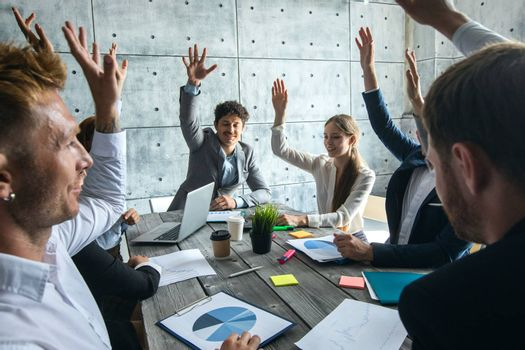 Business people at meeting raising hands, corporate cooperation success team concept, people working with financial data reports