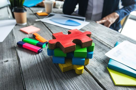 Puzzle pieces on office meetng table, business vision and problem solution concept